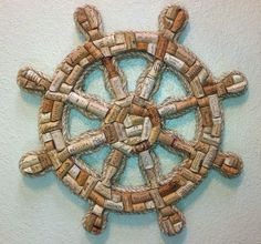 Wine Cork Ships Wheel Handcrafted ships wheel made with real wine corks. This unique item measures 21 inches across and comes ready to hang on your wall. Wine Craft, Wine Cork Crafts, Bottle Cap Art, Bottle Cap Crafts, Bottle Cap Projects, Wine Cork Art, Wine Corks, Wine Cork Wreath, Deco Marine