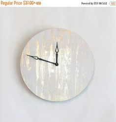 This gold and white wall clock is nothing less than cool. Custom handmade from a well loved record, it is the perfect harmony of glitz and glamour. The face of this clock is covered in decadent gold foil wood grain pattern that commands attention. It will make a sensual addition to your boudoir or anywhere else you want to make a bold statement. Youll fall in love all over again each time you glance at the time. This is a limited edition Shannybeebo design. Order now to guarantee…