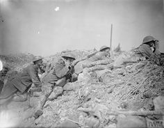 WWI, 8 April 1917, Battle of Arras. Officers of the 12th Div, Royal Artillery observing fire during the preliminary bombardment for the Arras offensive at Cuthbert Crater. Field telephonists of the Royal Engineers passing back results. Cuthbert Crater was located 2 and a half miles N-E of Arras and 1 mile north of Blangy. ©IWM Q 5095