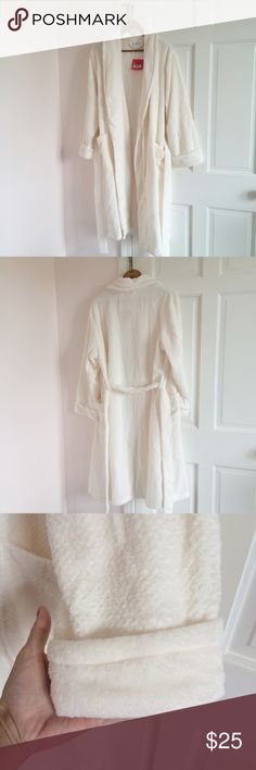 NWT Ulta Ivory Plush Robe Super soft ivory robe. Size L/XL. 100% polyester. Front pockets. Ties in front. New with tags. Ulta Intimates & Sleepwear Robes