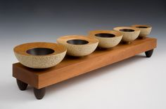 Birch bowls with painted interior and carved and painted exterior.