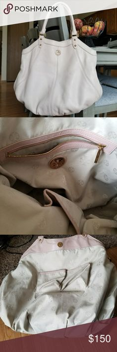 """Tory Burch Dakota Blush Colored Hobo Beautiful Shoulder bag in a blush pink color.  Good Condition   Handles have some rubbing. Outside has no major markings nor does the corners. A few marks inside.   No Shoulder Strap. Can fit snuggly on the shoulder, wrist or carried in hand.  18.5"""" X 14""""  Strap Drop 7""""  No dust bag or box Tory Burch Bags Shoulder Bags"""