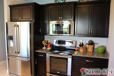 Rich, espresso cabinets with stainless steel appliances Discount Kitchen Cabinets, Espresso Cabinets, Kitchen Dinning, Kitchen Design, Kitchen Ideas, Home Kitchens, New Homes, Kitchen Appliances, Kitchen Remodeling
