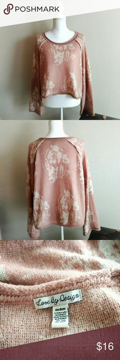 Love By Design Cropped Sweater Pink and white floral sweater with a high-low hem and flared sleeves from Nordstrom. Soft and warm, perfect for colder weather! Size Medium, 72% Acrylic, 28% Nylon. Love By Design Sweaters Crew & Scoop Necks