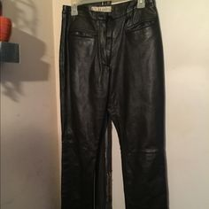 100% Genuine Black Leather Pants Sz 4 Petite These are in GREAT CONDITION 100% Genuine Black Leather Pants. Has the knee seam. Elastic gathering on sides in the back of pants. For great fit! Overall Great👍🏽 Pants Boot Cut & Flare