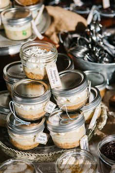 Wedding cake served individually in mason jars with lids, easy to serve multiple flavors and take home!
