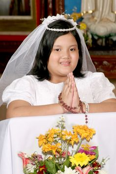 Maica prepares for her First Communion