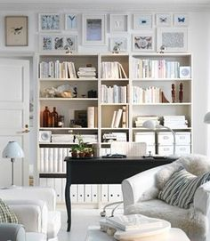 """use IKEA """"billy"""" book shelves to mix n match and putting pictures on top"""
