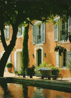 Another Provence maison with a lovely mellow colour scheme;  the courtyard has a beautiful stone basin.