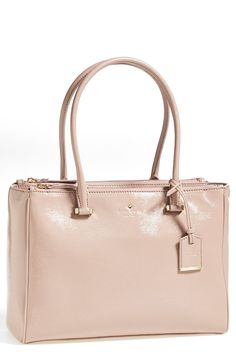This classic style Kate Spade tote is perfect for the office.