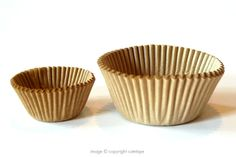 Unbleached kraft cupcake liners.Choose either 100 mini (1-1/4 inch)75 standard (2 inch) $2.05