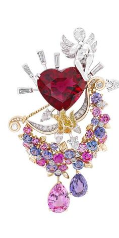 Van Cleef & Arpels Secrets Amoreaux brooch with ruby, pink and purple sapphires, with yellow and colourless diamonds