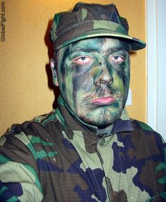 a gay mans war face painted camoflauge pictures