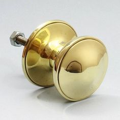 An elegant solid cast brass door centre pull. Age uncertain but heavily tarnished and painted when found. Stripped of paint and fully restored then polished. In excellent condition with no surface blemishes. Supplied complete with long replacement fixing stud and nut/washer suitable for doors up to 6cm, longer stud available on request.