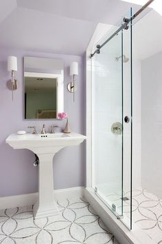 Charming Lavender Bathroom Features Ann Sacks Chrysalis Tiles Positioned Beneath A White Pedestal Sink