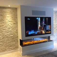 We have designed and built this media wall with split button tiles. the fire is 2000mm wide. The depth of the fire breast is such due to the full AV rack built into the side. This houses the full atmos designed AV receiver and dedicated twin in wall subwoofer amplifier. Starting out as a flat wall, the change has been dramatic, not only visually but audibly.... Living Room Decor Fireplace, Fireplace Tv Wall, Living Room Decor Cozy, Fireplace Design, Home Decor Bedroom, Feature Wall Living Room, Living Room Setup, Living Room Built Ins, Open Plan Kitchen Living Room