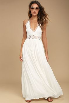 Lulus Exclusive! There's no doubt that the This is Love White Lace Maxi Dress is a true stunner! From adjustable spaghetti straps, gauzy rayon falls to a plunging V-neck with crocheted lace trim. Sheer lace waist tops the full maxi skirt. Hidden back zipper.