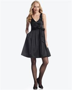 llusion Tank Dress  Style: 570033268   Stunning satin date dress with sheer illusion back and dramatic keyhole. Sleeveless V-neck silhouette tailored with princess seams, an inset waist and pleated skirt with secret on-seam pockets.