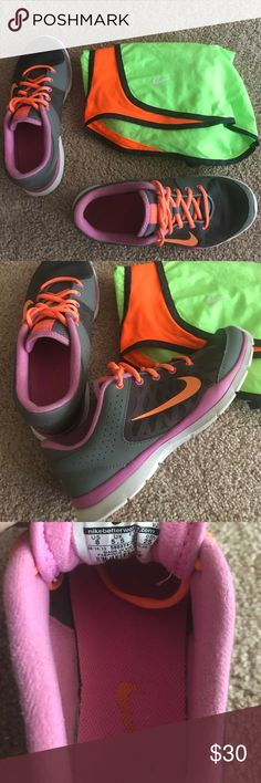 Nike training sneakers Grey, orange, and purple! Worn only a few times still in almost new condition! Only flaw is the bottom (shown in pictures) ideal for lifting or Crossfit! ➡️ I am willing to trade for Nike 8.5!! ⬅️ Nike Shoes Sneakers