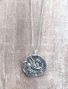 A pretty silver Pegasus charm on a sterling chain.