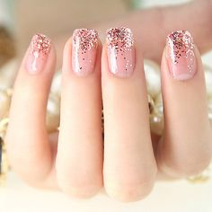 Pink nails with glitter. I love these! This is how I'm in vision my prom nails except with a mint green color to go with my dress.