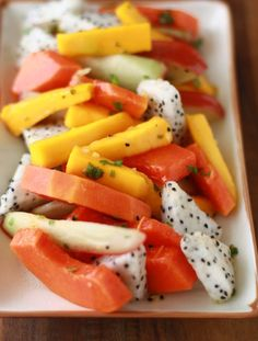 tropical fruit salad with ginger mint dressing.