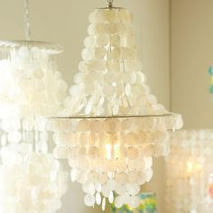 copeiz lighting in bedroom | Cascading capiz shells bring a beachy vibe to your space. Lit from ...