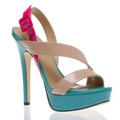 Tempt yourself with sky-high Tai, a luxe colorblocked platform sandal that crushes the competition.