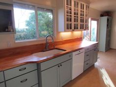 Photo gallery of remodeled kitchen features CliqStudios Rockford Painted Linen cabinets with bumped out cabinets for built-in furniture style Linen Cabinets, White Cabinets, Kitchen Cabinets, North Babylon, Kitchen Ideas, Kitchen Design, Built In Furniture, Glass Doors, Beautiful Kitchens