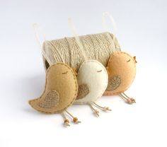 Set of 3 nice hand sewn felt bird ornaments. Each comes with a transparent ribbon attached so you can hang them anywhere. You can use them as