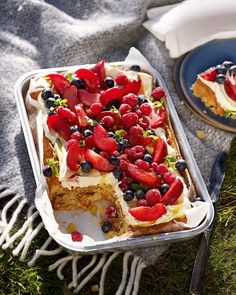 Light marzipan sponge is topped with creamy mascarpone icing, wonderfully fresh berries and plums to make a proper afternoon treat for warm summer days.