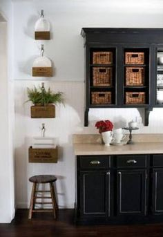 Black Painted Kitchen Cabinets - I like the colors (and baskets).