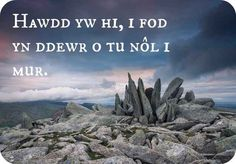"""Welsh: """"Hawdd yw hi, i fod yn ddewr o tu nôl i mur."""" Approximate pronunciation: howth yew hee, ee vohd un thewr oh tee nohl ee meer Translation: """"It is easy to be brave from behind a wall. Welsh Sayings, Welsh Words, Welsh Tattoo, Learn Welsh, Welsh Language, Words Of Hope, Knowledge And Wisdom, Cymru, Writing Poetry"""