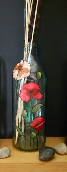 Add some beauty to your decor with an upcycled bottled.  Use as is, or fill with rocks, sand, candies, salt, sugar, etc.