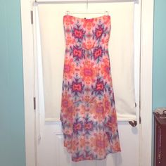 Aztec bright orange and pink lo-hi dress Strapless Aztec pattern dress. Beautiful colors of oranges, pinks, blues, and purples. Has an orange slip dress under. Front is short and back goes almost mid calf. Gathers at waist. Size XL. Name brand is Snap. Retail for $35 Snap Dresses High Low