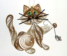 Quilled / Filigree Kitty Cat Hanging Ornament: Cappuccino Brown, Caribbean Green Colored Eyes with aTiny Gray Mouse Held in Paw.  via Etsy.