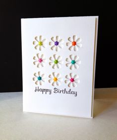 handmade birthday card from I'm in Haven ... 3X3 grid of negative space daisy die cuts ... popped panel makes extra shadow depth ... luv the enamel dot centers in bright colors ...