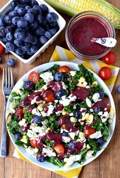 Best of Summer Kale Salad with Blueberry-Balsamic Vinaigrette features summer's best produce like sweet corn, blueberries and cherry tomatoes on a bed of hearty, healthy kale. | iowagirleats.com