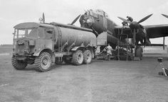 An AEC 854/O854 Matador refuels Avro Lancaster B I R5868 'S-Sugar' at RAF Hunsdon after completing its 100th operation the previous evening against Bourg Leopold in Belgium on 12 May 1944