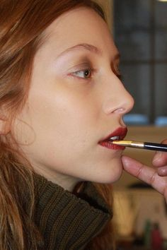 """A Lazy Girl's Guide to Hair and Makeup at Derek Lam: When working with shadows with a lot of pearl or glitter, Pecheux likes to use his fingers to make the color glide. This also prevents a flaky finish. """"I'm using my finger for everything. The heat of the finger warms the product, and you really manage to melt it together,"""" he said. To finish the palette, Pecheux dabbed on a bold burgundy lip stain (Pure Color High Intensity Lip Lacquer in Electric Wine) by hand, too."""