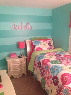 Girls teal stripe wall and Isabella wall decal from Etsy. Sherwin Williams Tantalizing teal paint and Synergy as the second color.