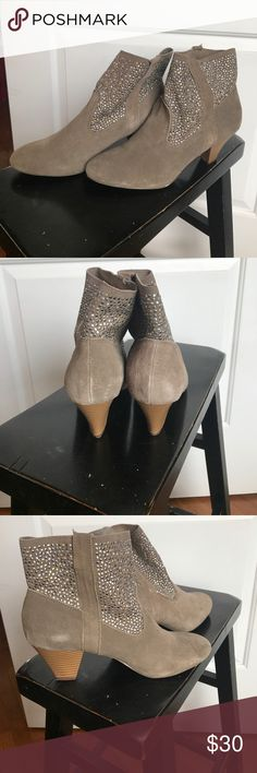 American Eagle suede booties Light brown suede with metal adornments! Size 10. American Eagle brand. Small heel, no platform. Worn maybe a couple of times. American Eagle Outfitters Shoes Ankle Boots & Booties