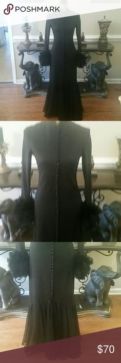 Vintage stunner!  Feathers, buttondown front...yum Black vintage gown, features feather cuffs, buttons down the front, and beautiful swing skirt in tulle. Size 10. Vintage  Dresses Maxi