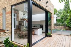 Southern Windows - gorgeous house extension with Slim sliding patio doors and glazed corner.