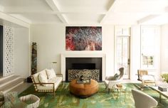 This sunken living room was originally two stories, but Joe Nahem of Fox-Nahem lowered it to 11 feet to give more space to the second floor. The room features midcentury furniture and a handmade area rug from Fedora Design.   - Veranda.com