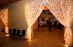 Fantastic use of fariy curtain lights at a wedding - We could use shower curtains for our venue