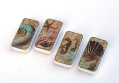 This set of 4 sea shell magnets have a fun beach theme. The domino magnet set has images of a seahorse, starfish, nautilus and clam shell images on the face of the domino magnets. The images are highlighted with glitter and subtle color to enhance the image. This beach theme magnet set will be sure to add some color to your kitchen refrigerator or office cabinets. The domino magnets make for fun gift ideas as well.  Genuine domino game pieces were altered with vintage shell, starfish…
