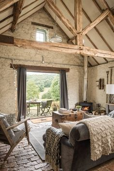 love this modern rustic barn farmhouse with bifold french doors and views to the terrace and rustic brick floor. Click through for more modern rustic farmhouse interiors ideas you'll love French House, Home, Rustic House, French Country House, Bifold French Doors, Brick Flooring, House Interior, Farmhouse Interior, Barn Renovation