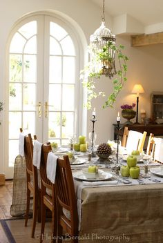 traditional dining room with a lovely birdcage and bright french door