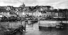 Old photograph of fishing boats at the entrance to the inner harbour at Pittenweem, East Neuk Of Fife, Scotland